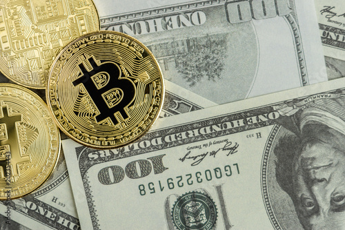 golden bitcoin coin on us dollars. Cryptocurrency business concept