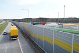 Highway. Acoustic wall that protects residents against noise generated by passing trucks and cars. - 202386863