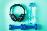 Sport flat lay composition with dumbbells and headphones - 202389208