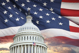 US Capitol dome with American flag and dramatic sky behind - 202389602