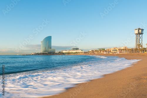 Fotobehang Barcelona Barceloneta Beach in Barcelona with colorful sky at sunrise. Seafront, beach,coast in Spain. Suburb of Barcelona, Catalonia