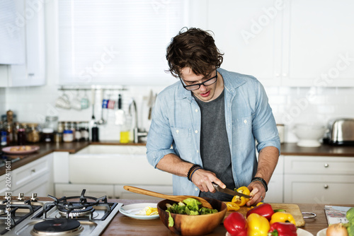 Caucasian man cooking in the kitchen - 202411611