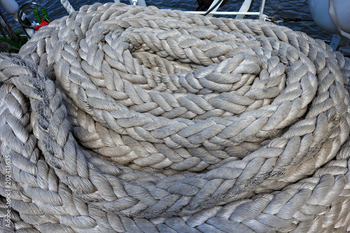 Thick white ropes on a sailing ship.