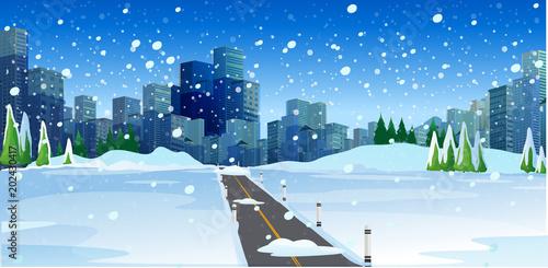 Snowy Road in Big Modern City