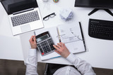 Elevated View Of Businessperson Calculating Invoice - 202431001