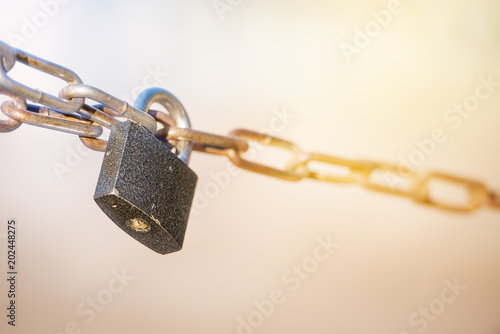 metal lock with chain on blurred Sunny background