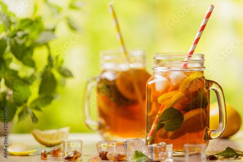 Fototapeta Iced tea with lemon and ice cubes