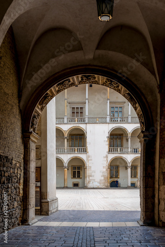 Krakow, Poland - August 13, 2017: beautiful architectural arch and a view of the columns of the royal palace in the castle of Wawel © kosmos111