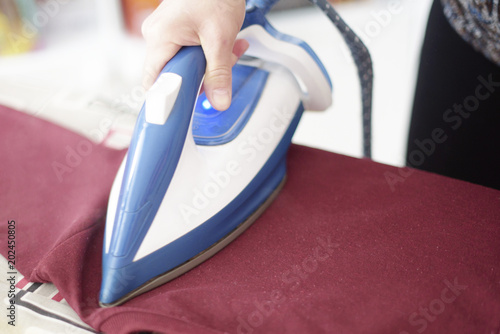 Ironing clothes with steam