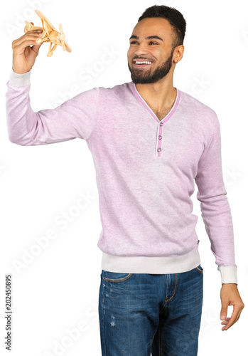 Black man with a toy plane isolated on white background