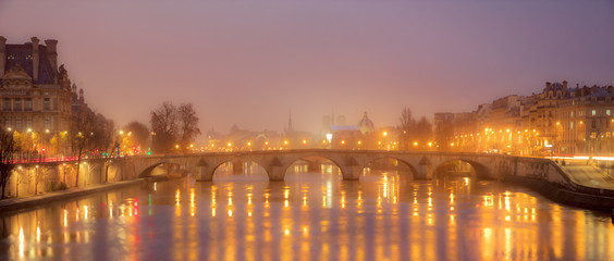 View over The Seine in the city of Paris at night with colorful lights- Paris, France, Europe