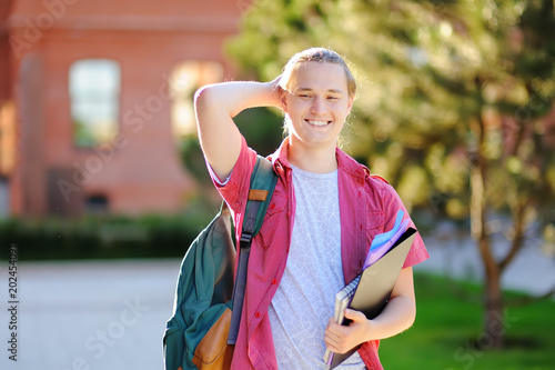 Smart successful young student in University campus