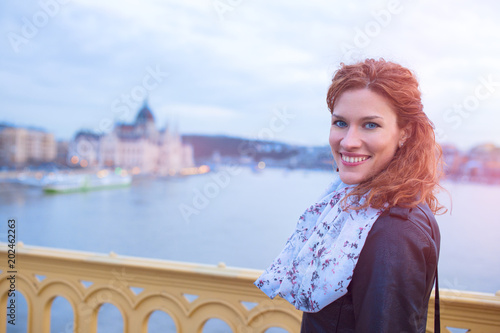 Young beautiful redhead woman smile at Budapest, Hungary
