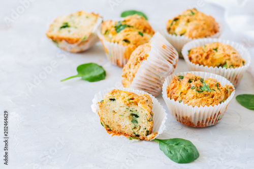 Savory potato spinach and feta muffins on a white stone background. Copy space.