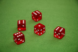 Red dices of a casino on a green table