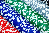 Playing casino chips of different color and dignity
