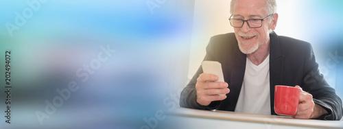 Senior man using his phone, light effect