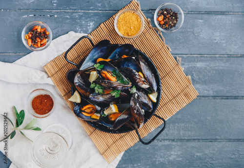 Delicious seafood fresh mussels on wooden table. Top view