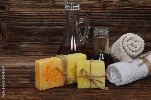 Musky aroma soap, argan oil for the body and clean towels