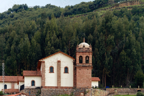 San Cristobal Church in Cusco (Peru) on the top of a hill with a grove of trees