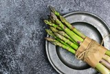 Fresh asparagus isolated on the dark background - 202549275