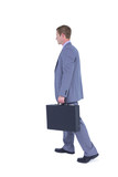 Handsome businessman holding a suitcase - 202550477