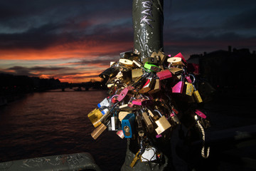 Love locks locked on a Seine River Bridge in Paris, France