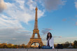 Beautiful woman drinking a glass of wine at the Eiffel Tower in Paris, France