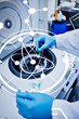 Science and medical graphic against close up of a chemist using a centrifuge