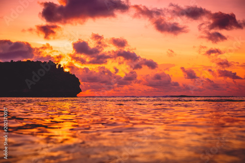 Aluminium Oranje eclat Waves in ocean and sunset with clouds. Ocean with sunset colors