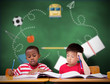 Cute pupils writing at desk in classroom against green chalkboard