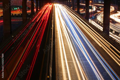 Fototapeta Speed Traffic - light trails on the road at night, long exposure