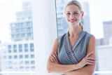 Smiling businesswoman standing in the office - 202580232