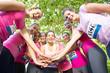 Smiling women running for breast cancer awareness
