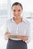 Smiling businesswoman using a tablet - 202585886