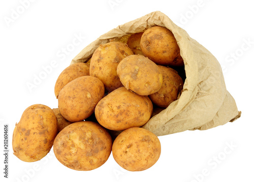 Fresh new potatoes in a brown paper bag isolated on a white background