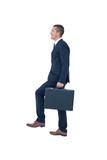 Businessman climbing with briefcase - 202619241