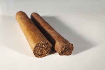 Two Cuban cigars ready to smoke