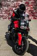 Постер, плакат: Brutal motorcyclist on a super bike
