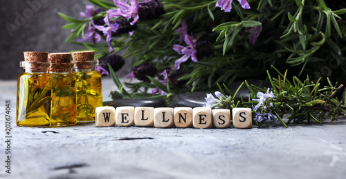 lavender oil in a glass bottle on a background of fresh flowers. - 202674048