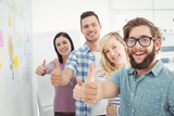 Portrait of smiling business people with thumbs up  - 202690882