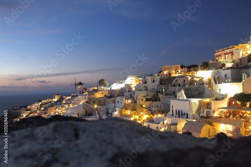 Plexiglas Santorini Night falls on Santorini, Greece