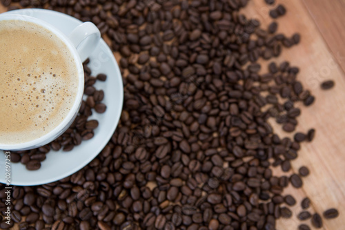 Cup of coffee with roasted coffee beans - 202697253