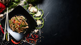 traditional oriental cuisine food preparing craft. rice noodle beef and vegetable on a plate. copyspace concept - 202707215