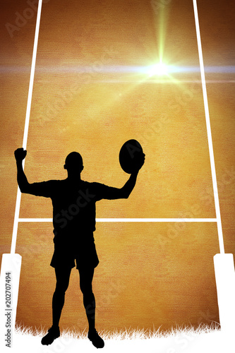 Silhouette of rugby player against orange background