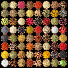 Spices and herbs isolated on black background. Various spices for food
