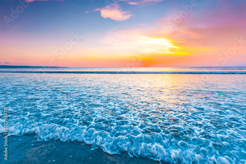 Fotobehang Strand Radiant sea beach sunset