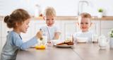 happy funny children eating breakfast - 202768648