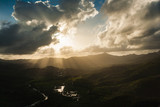 Aerial View of a Sun Beams, Clouds Mountains and Valley at Sunset, in St. Lucia