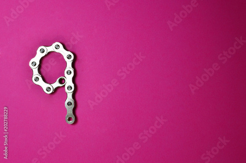 bike chain number nine on pink background